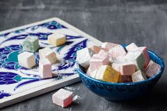 Turkish delight lokum in a blue bowl Stock Photos