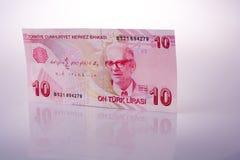 Turksh-Lirabanknoten von 10 auf weißem Hintergrund Lizenzfreie Stockfotos