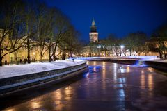 Turku, Finland, beautiful view of Aura river. Turku, Finland, beautiful view of Aura river at clear winter night with street lights and with a clock tower of royalty free stock images
