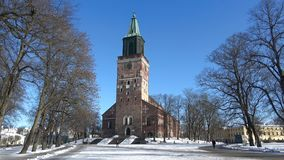 Turku Cathedral on a sunny february day. Finland. TURKU, FINLAND - FEBRUARY 23, 2018: Turku Cathedral on a sunny february day stock footage