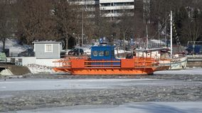 Ferry `Fiori` on the winter river Aura. Sunny February day. Turku, Finland. TURKU, FINLAND - FEBRUARY 23, 2018: Ferry `Fiori` on the winter river Aura. Sunny stock video