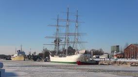A view of the sailing ship Suomen Joutsen at the city waterfront. Turku, Finland. TURKU, FINLAND - FEBRUARY 23, 2018: A view of the sailing ship Suomen Joutsen stock video