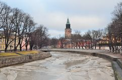Turku in winter. Turku, Finland. The embankment of the frozen river Aura in a winter day Stock Photos