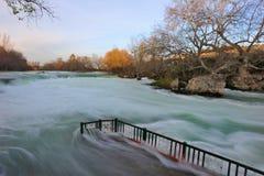Turley. Antalya. Manavgat waterfall at a sunset. Flood water runs through cafe Royalty Free Stock Photo
