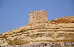Turm auf Küstenfelsen Lizenzfreie Stockfotos