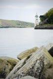 Turm durch das Meer Stockbilder