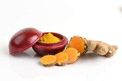 Turmaric (Curcuma longa L.)and powder. Turmaric and powder,natural spa ingredients with medicinal properties Royalty Free Stock Photography