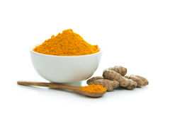 Turmeric. Bowl of turmeric powder with fresh turmeric root