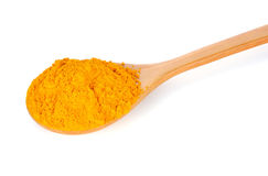 Turmeric (Curcuma) powder on wooden spoon Royalty Free Stock Images