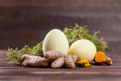 Turmeric easter eggs. Natural easter egg dyeing yellow with turmeric stock image