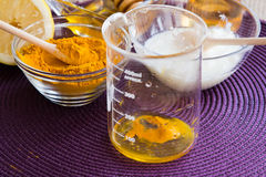 Turmeric face mask set. Preparation of the Turmeric face mask receipt set. Put ingredients in a beaker step Royalty Free Stock Photos