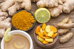 Turmeric, ginger and lemon on the table stock photos