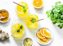 Free Turmeric, Ginger, Orange Lemonade. Summer Cold Drink On Light Background, Top View Stock Photos - 115600423