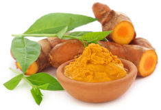 Turmeric with henna leaves. Over white background stock photography