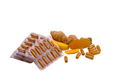Turmeric herbal capsules and  fresh turmeric root isolated on white Stock Photography