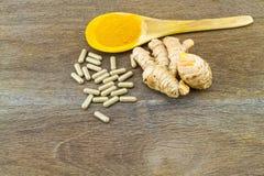 Turmeric herbal capsules ,fresh turmeric root  and turmeric powd Stock Images