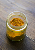 Turmeric jar over wooden table Stock Image