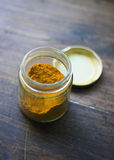 Turmeric jar over wooden table royalty free stock images