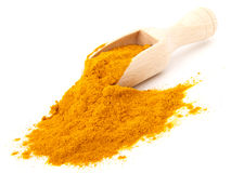 Turmeric over the spoon Stock Photos