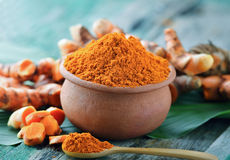 Turmeric powder in ceramic bowl Stock Photos