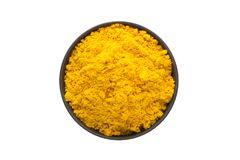 Turmeric powder in clay bowl isolated on white background. Seaso Stock Image