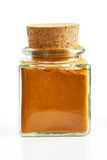 Turmeric powder in glass spice jar. With wooden cork,  on white background Stock Photos