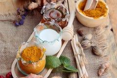 Turmeric powder with honey and milk for scrub. Royalty Free Stock Photo