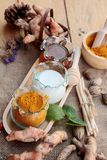 Turmeric powder with honey and milk for scrub. Stock Photo
