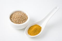 Turmeric Powder And Mustard Seeds Royalty Free Stock Photos