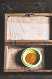 Turmeric powder on plate in a wooden box Stock Photos