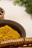 Turmeric powder in pottery Royalty Free Stock Photo
