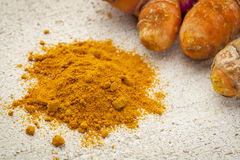 Turmeric powder  and root Royalty Free Stock Images