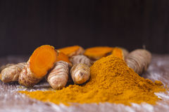 Turmeric powder and roots Stock Photos
