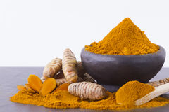 Turmeric powder and roots. Powder and turmeric roots on different backgrounds Stock Images