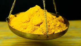 Turmeric powder spice and medicine. Turmeric powder on a weight stock video footage