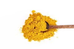 Turmeric powder with spoon. Turmeric powder isolated on white Royalty Free Stock Photography
