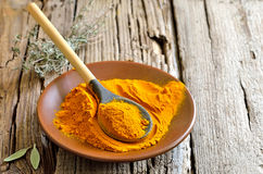 Turmeric powder. Traditional indian spice widely used in cooking and medicine Stock Image