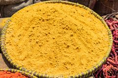 Turmeric powder on the trays in the market royalty free stock images