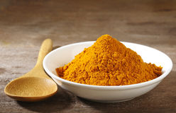 Turmeric powder in white dish royalty free stock photo