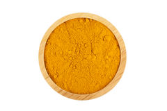 Turmeric powder in wooden bowl. Isolated on white background with clipping path Stock Photography