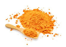 Turmeric powder in wooden spoon isolated on white Stock Photography