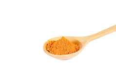 Turmeric powder in wooden spoon on white background. Stock Image
