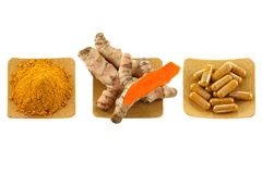 Turmeric rhizome, powder and capsules Royalty Free Stock Photos