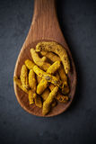 Turmeric rhizome  on a wooden spoon Royalty Free Stock Photography