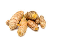 Turmeric rhizomes on white. A bunch of  fresh Turmeric rhizomes at eye level over white, not isolated Stock Image