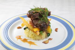 Turmeric rice junior beef short ribs with rice on plate Royalty Free Stock Photography