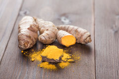 Turmeric root. Turmeric or curcuma root and spice Stock Images