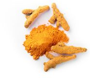 Turmeric root in dried and powdered form Stock Photos