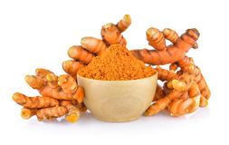 Turmeric root and dry tumeric in wood bowl Royalty Free Stock Photos