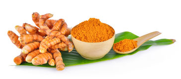 Turmeric root and dry tumeric in wood bowl Stock Image